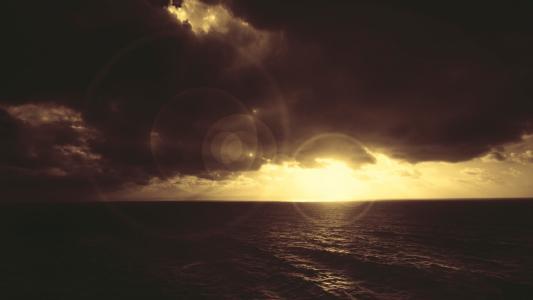 黑暗海洋日落高清壁纸